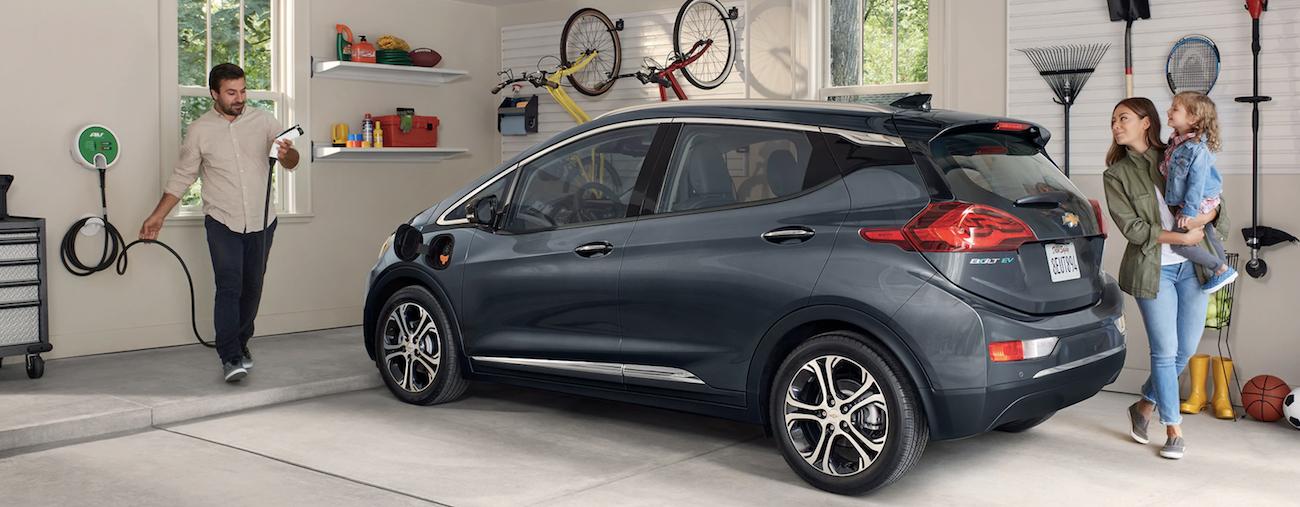 a dark gray 2019 Chevy Bolt being charged in a Cincinnati garage