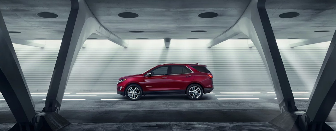A red 2019 Chevy Equinox in a huge concrete tunnel