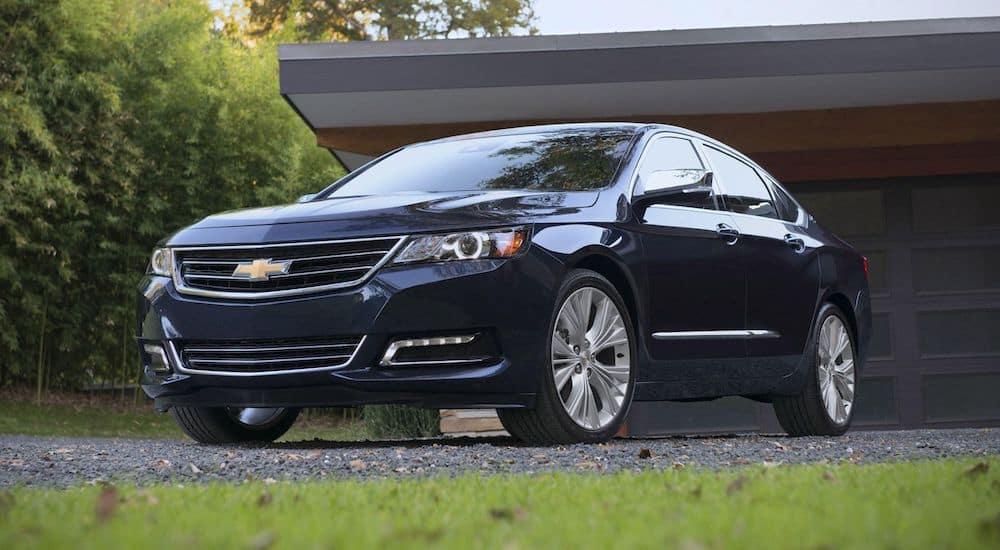 A blue 2019 Chevy Impala outside a Dayton Ohio home