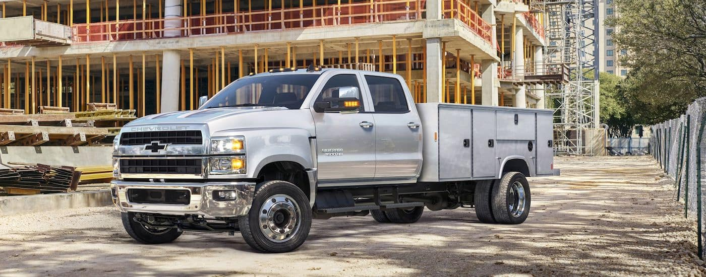 A silver Chevy Silverado HD work truck on a Cincinnati construction site