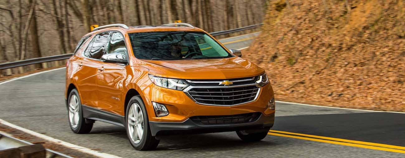 A bright orange 2019 Chevy Equinox, winner of the shootout between the 2019 Chevy Equinox vs 2019 Nissan Rogue