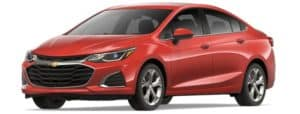 A red 2019 Chevy Cruze facing left