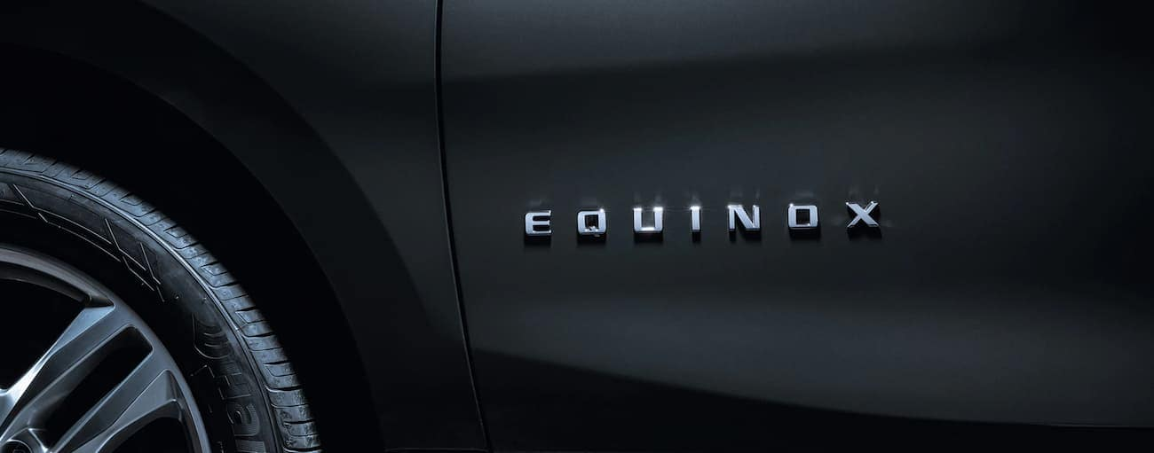 A closeup of the side badging on a grey Equinox signifying the victor of 2019 Chevy Equinox vs 2019 Kia Sportage