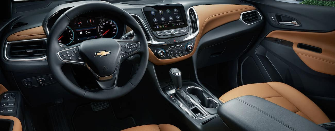 A look at the two-tone brown and black interior of a 2019 Chevy Equinox