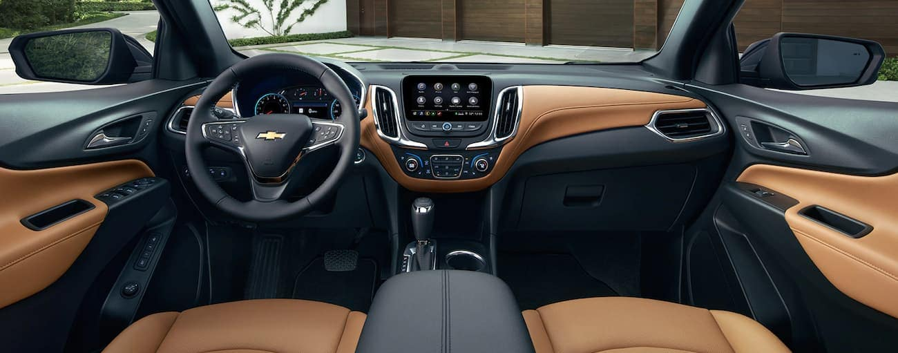 A two-tone brown and black interior of the 2019 Chevy Equinox