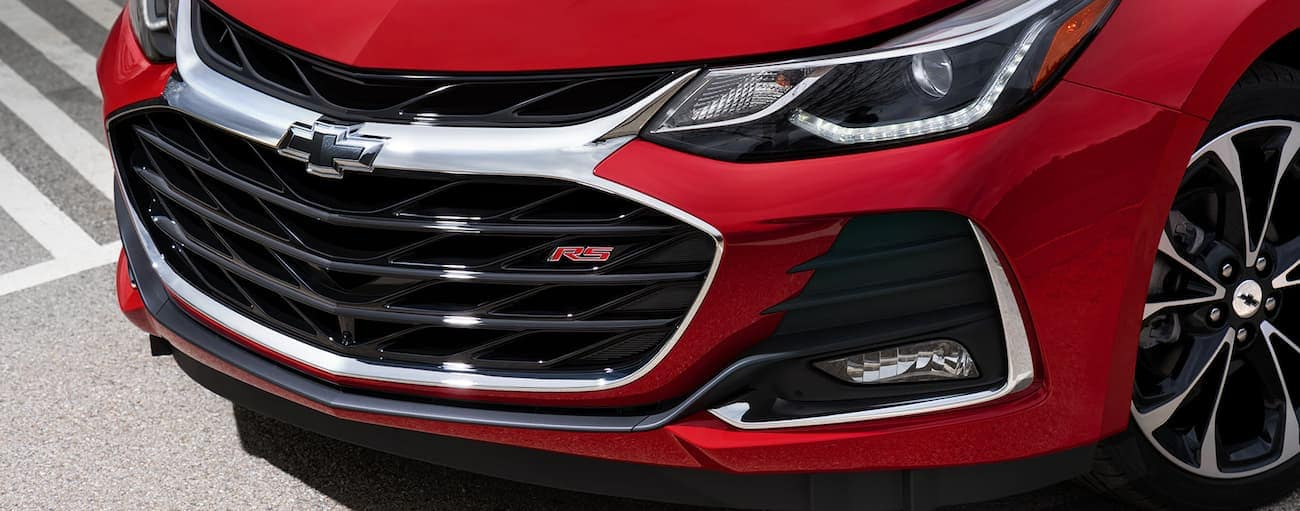 A closeup of the grille on a red 2019 Chevrolet Cruze RS