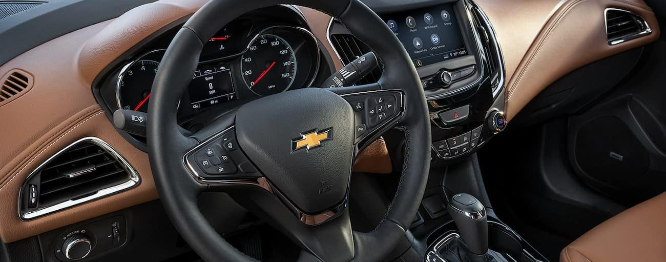 A closeup of the steering wheel and interior of a 2019 Chevy Cruze