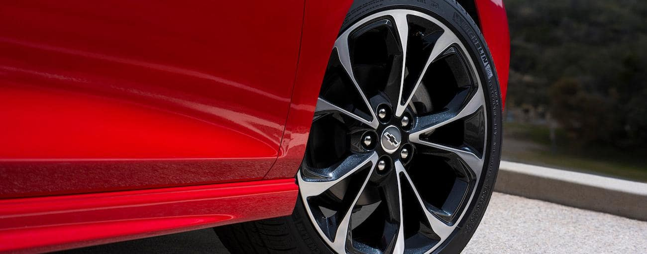 A closeup of the wheel on a red 2019 Chevy Cruze hatchback
