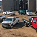 The 2019 lineup of Chevy's commercial vehicles is shown at a construction site.