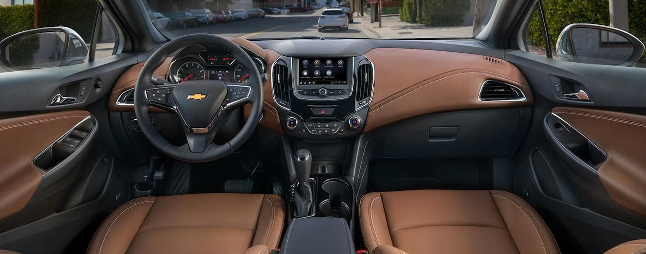 The two-tone brown and black interior of a 2019 Chevy Cruze