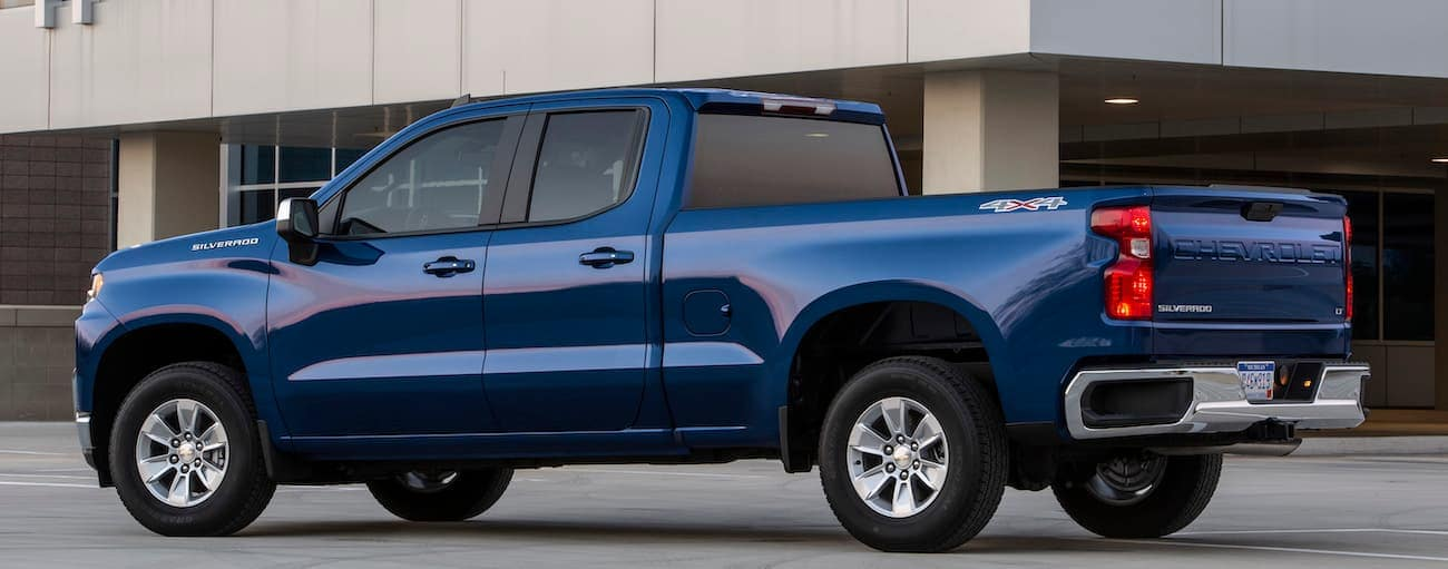 A blue 2019 Chevy Silverado is parked outside a building in Cincinnati, OH. Check out safety when comparing the 2019 Chevy Silverado vs 2019 Ford F-150.