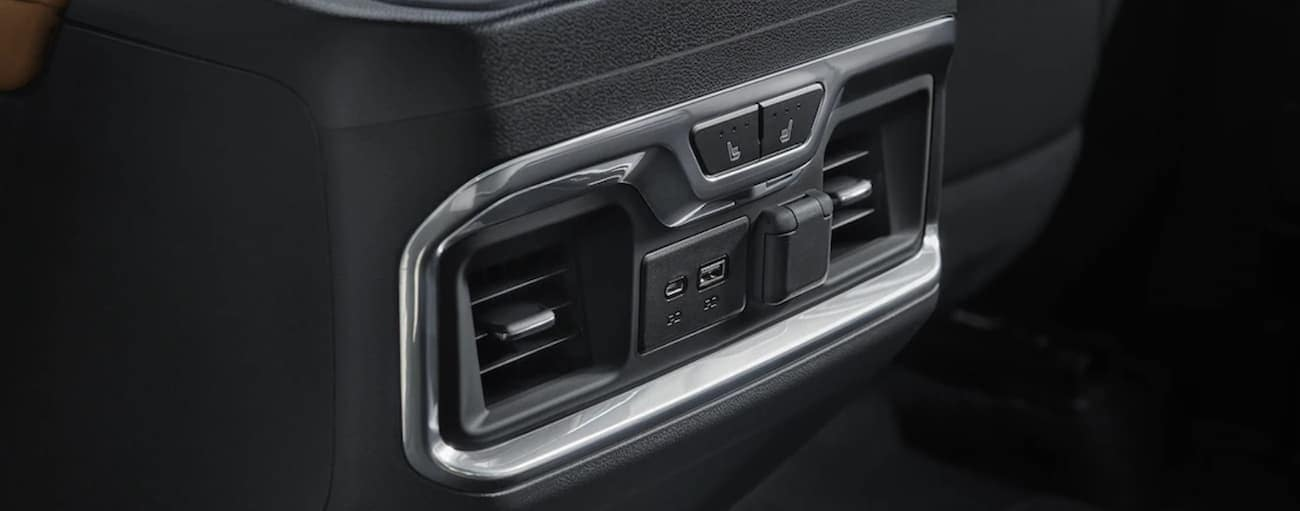 The charging features in the black interior of a 2019 Chevy Silverado are shown. Check out entertainment when comparing the 2019 Chevy Silverado vs 2019 Ford F-150 in Cincinnati, OH.
