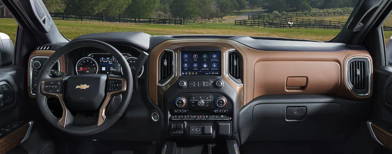 The brown and black interior of the 2019 Chevy Silverado is shown. Check out the entertainment features when comparing the 2019 Chevy Silverado vs 2019 Ram 1500 in Cincinnati, OH.