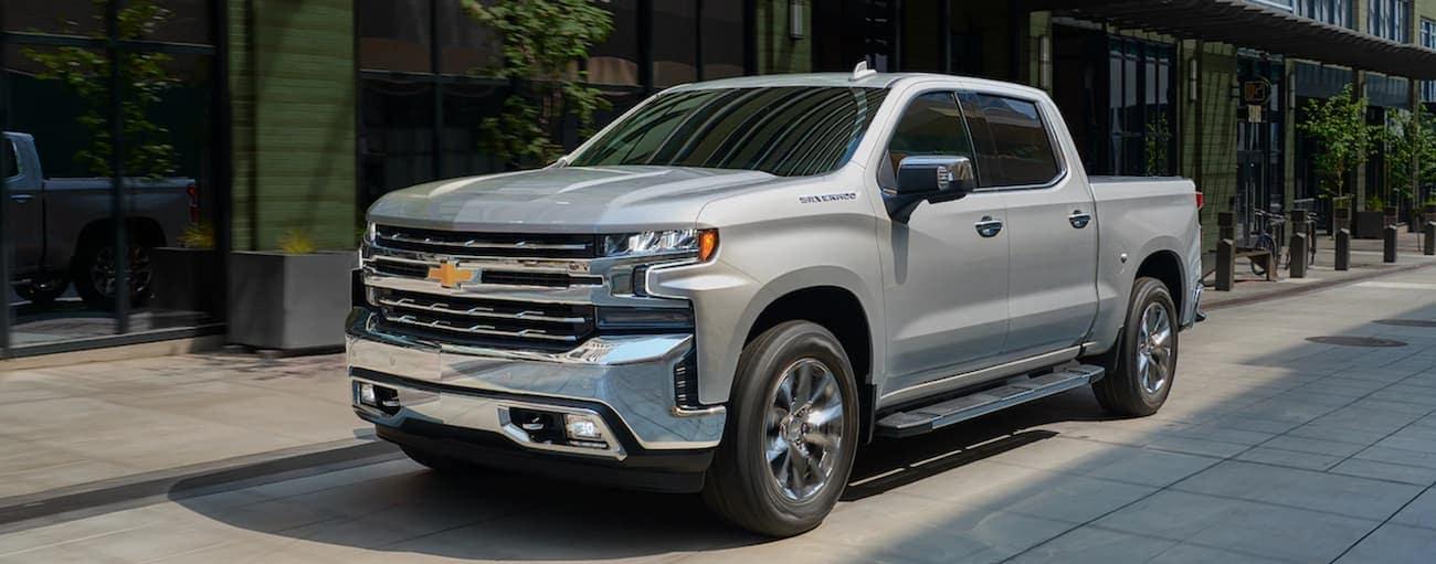 A grey 2019 Chevy Silverado is parked on a street in Cincinnati, OH.