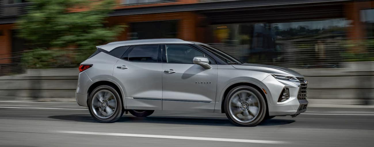 A silver 2019 Chevy Blazer is driving down the road in Cincinnati, OH.