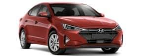 A red 2019 Hyundai Elantra is facing right.