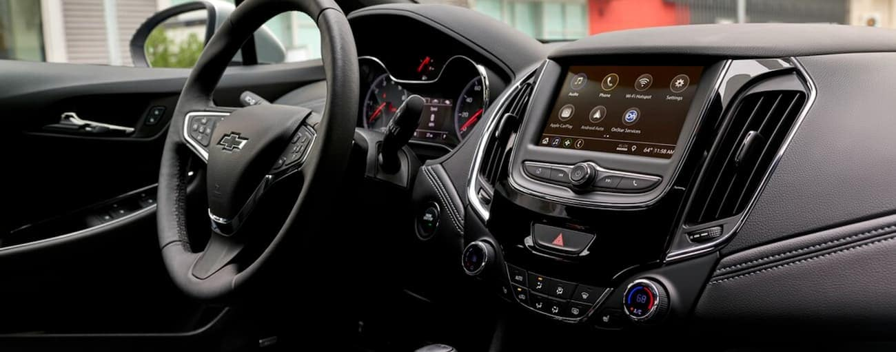 The entertainment system in the 2019 Chevy Cruze, which wins when comparing the 2019 Chevy Cruze vs 2019 Kia Forte in Cincinnati, OH, is shown.