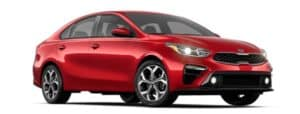 A red 2019 Kia Forte is facing right.