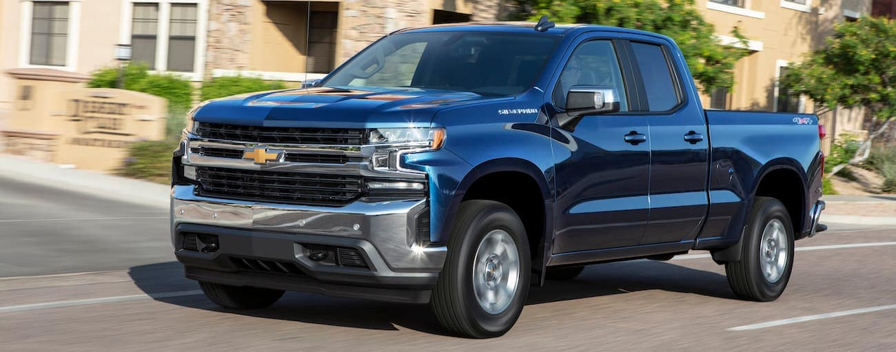 A blue 2019 Chevy Silverado is driving through town near Cincinnati, OH.