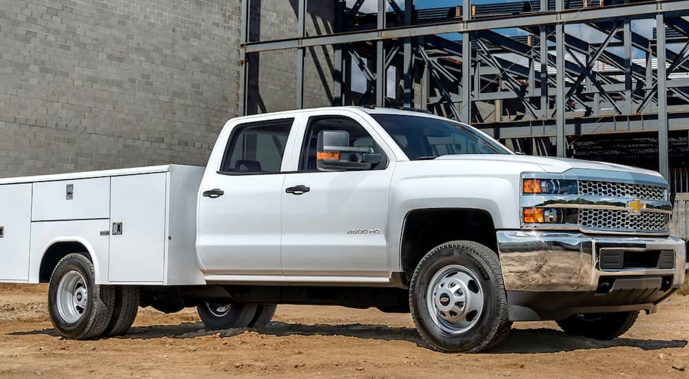 A 2019 Chevy 3500 with a utility bed, which is one of the many commercial vehicles that will be in Cincinnati, OH, is shown at a construction site.