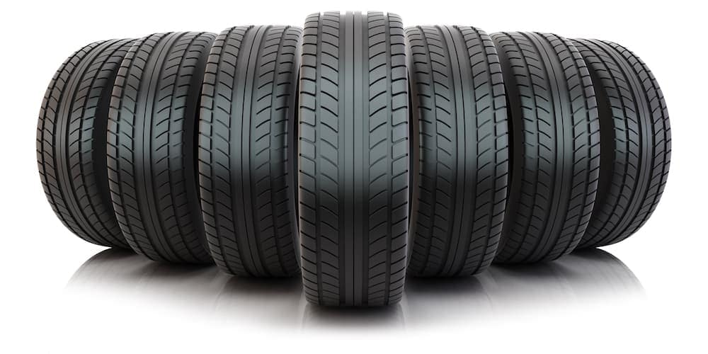 7 brand new tires are in a row, similar to discount tires in Cincinnati, OH you can buy.