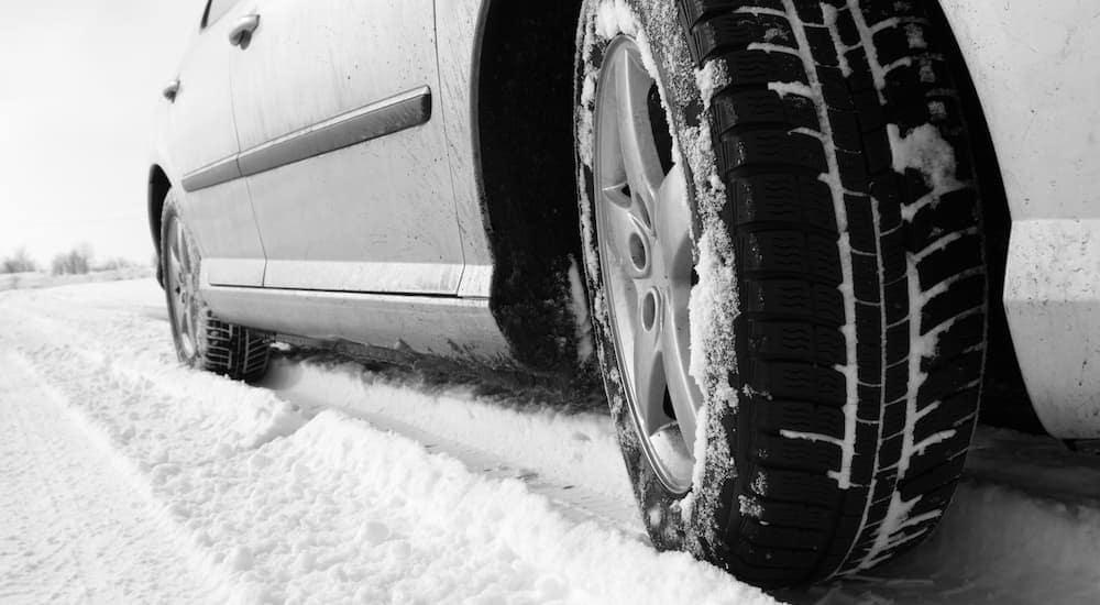 A close up of a tire going through the snow near Cincinnati, OH.