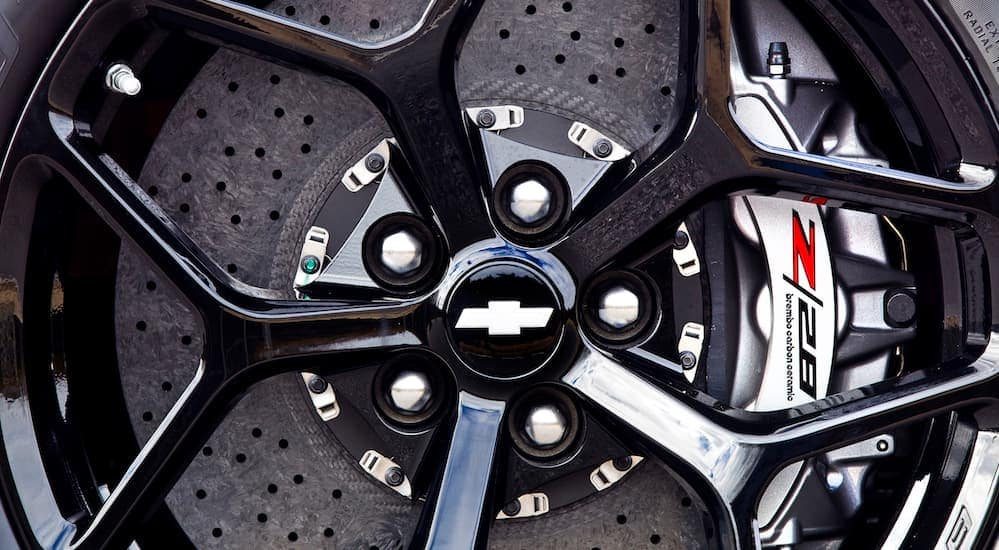 A close up of brakes and a wheel on a Chevy vehicle is shown.