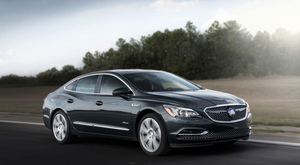 A 2019 Buick LaCrosse Avenir, which uses GM parts in Cincinnati, OH, is driving down a highway.