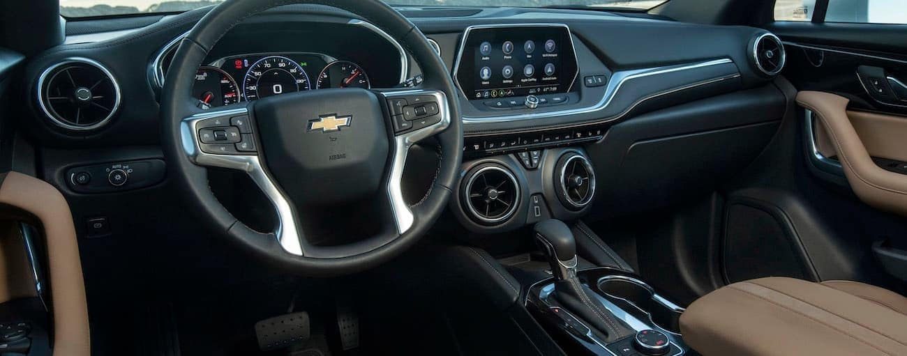 The black and brown interior of the 2019 Chevy Blazer is shown.