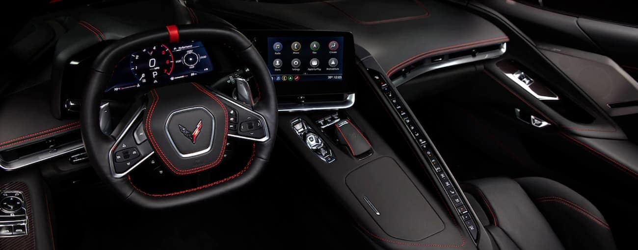 The black and red interior of a 2020 Chevy Corvette is shown.