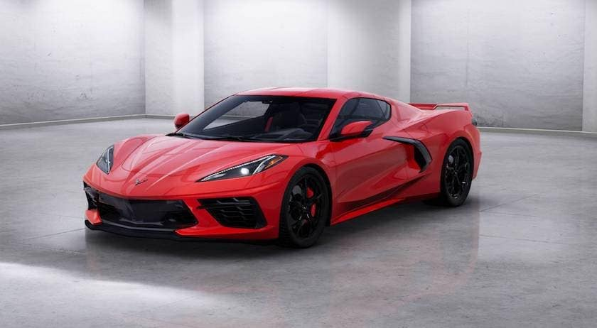 A red 2020 Chevy Corvette is facing left in a white room.
