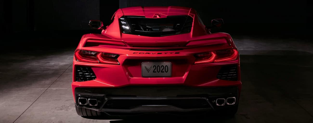 The rear end of a red 2020 Chevy Corvette is shown in a dark room in Cincinnati, OH.