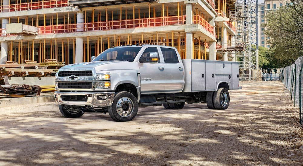 A silver 2019 Chevy Silverado 4500 HD is parked at a construction site.