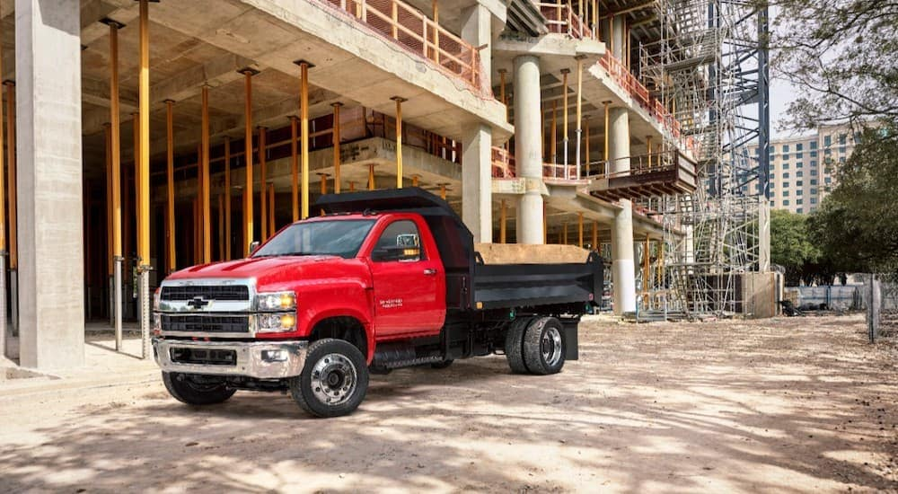 A red 2019 Chevy Silverado 6500HD is at a Cincinnati, OH construction site.