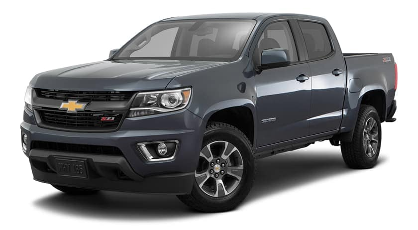 A dark blue 2016 Chevy Colorado is parked and facing left.