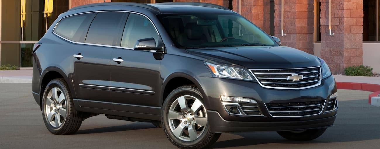 A blue 2017 Chevy Traverse, which wins when comparing the 2017 Chevy Traverse vs 2017 Hyundai Santa Fe, is parked in a parking lot near Cincinnati, OH.