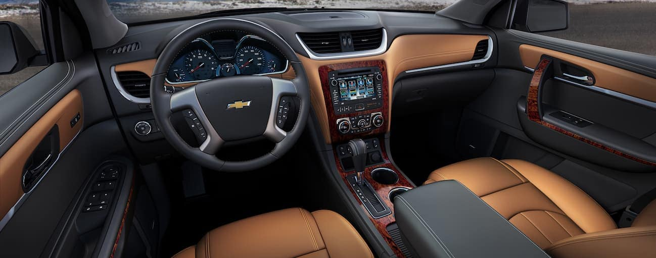The black and brown leather interior of a 2017 Chevy traverse.