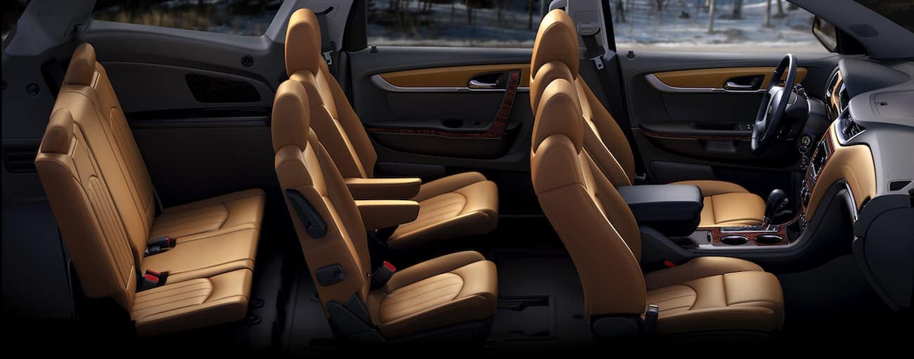 The brown and black leather interior os the 2017 Chevy Traverse is shown from a birds-eye-view.