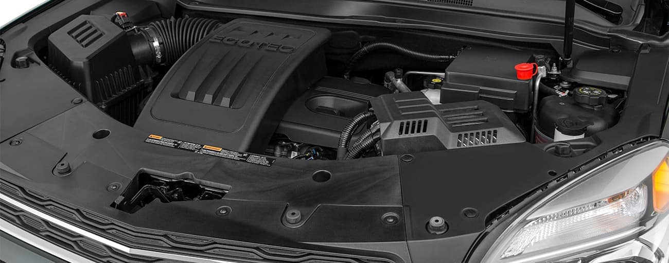 The engine bay of a 2017 Chevy Equinox is shown.