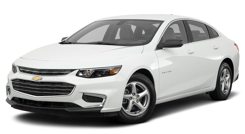 A white 2017 Chevy Malibu is parked and facing left.