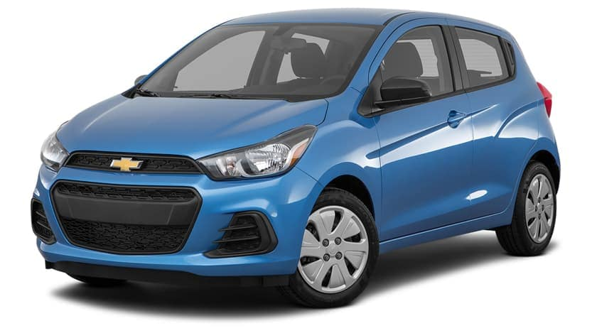 A blue 2017 Chevy Spark is parked and facing left.