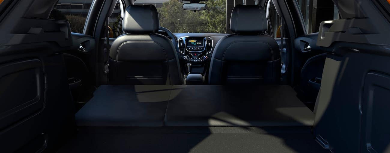 Rear black interior look at the 2018 Chevy Cruze is shown.