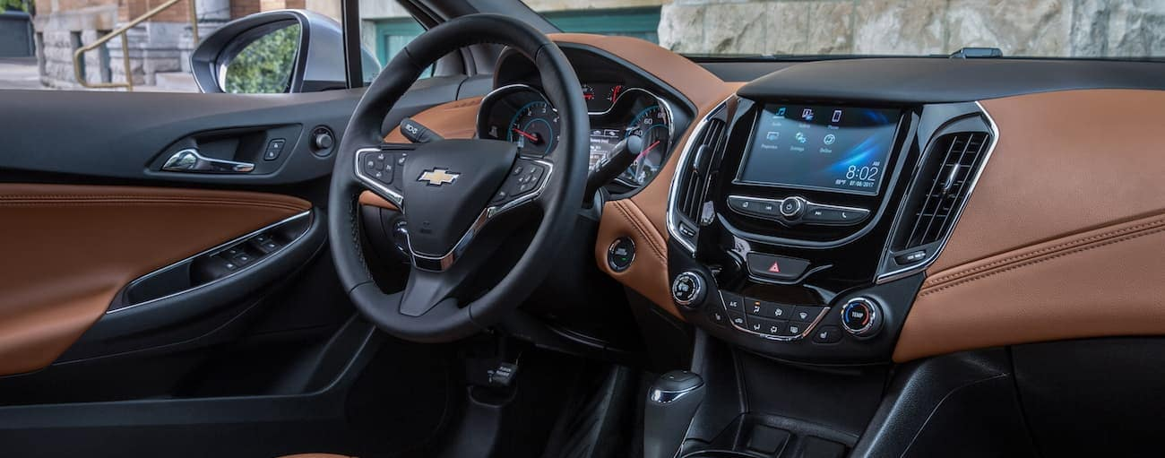 The black and brown leather interior of the 2018 Chevy Cruze.