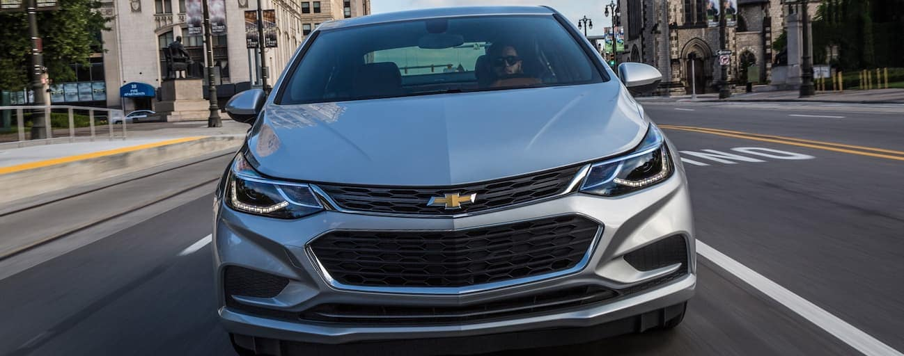 A close up of the front end of a silver 2018 Chevy Cruze is shown.