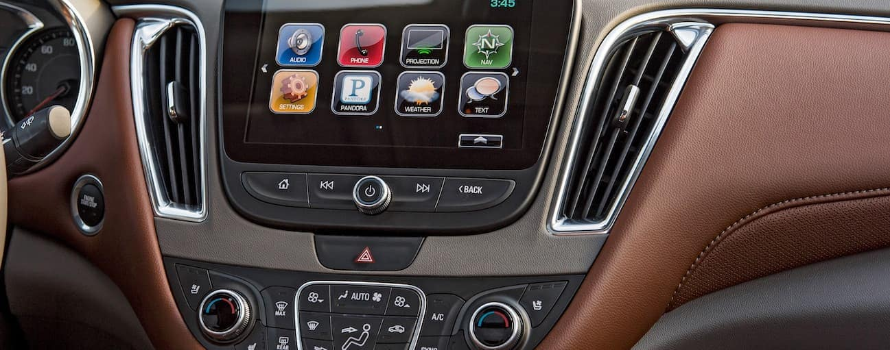 The brown and grey leather trim in the 2018 Chevy Malibu is shown.