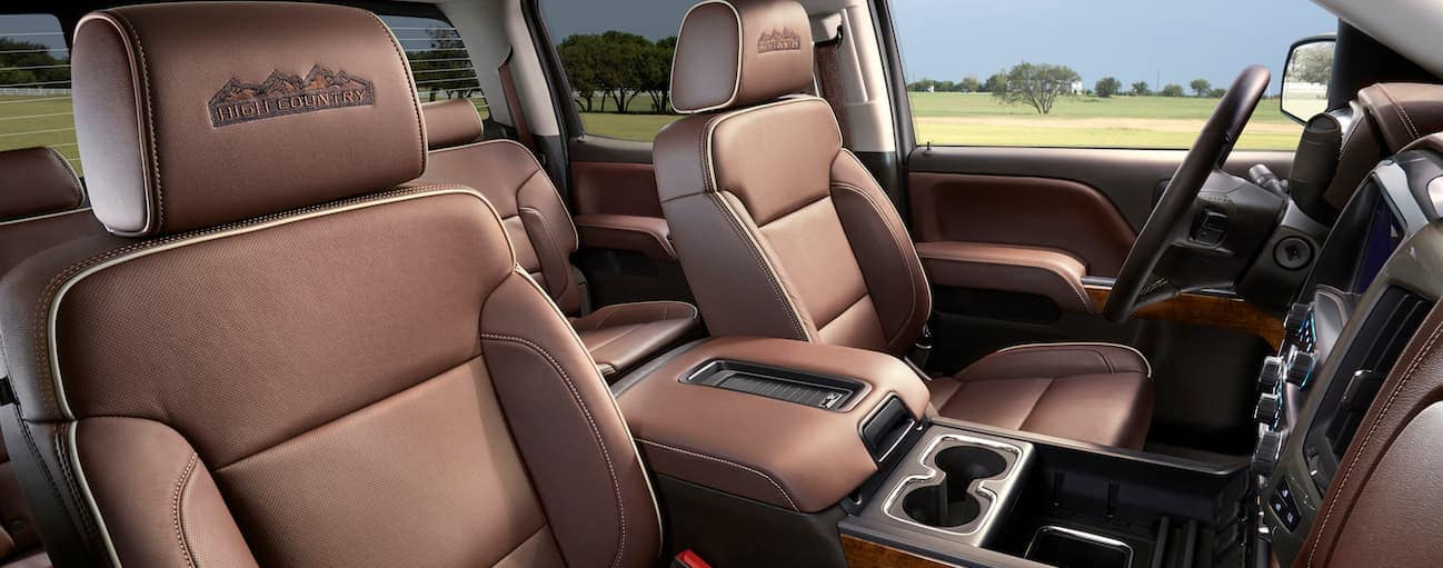 The brown and black interior of a 2018 Chevy Silverado is shown.
