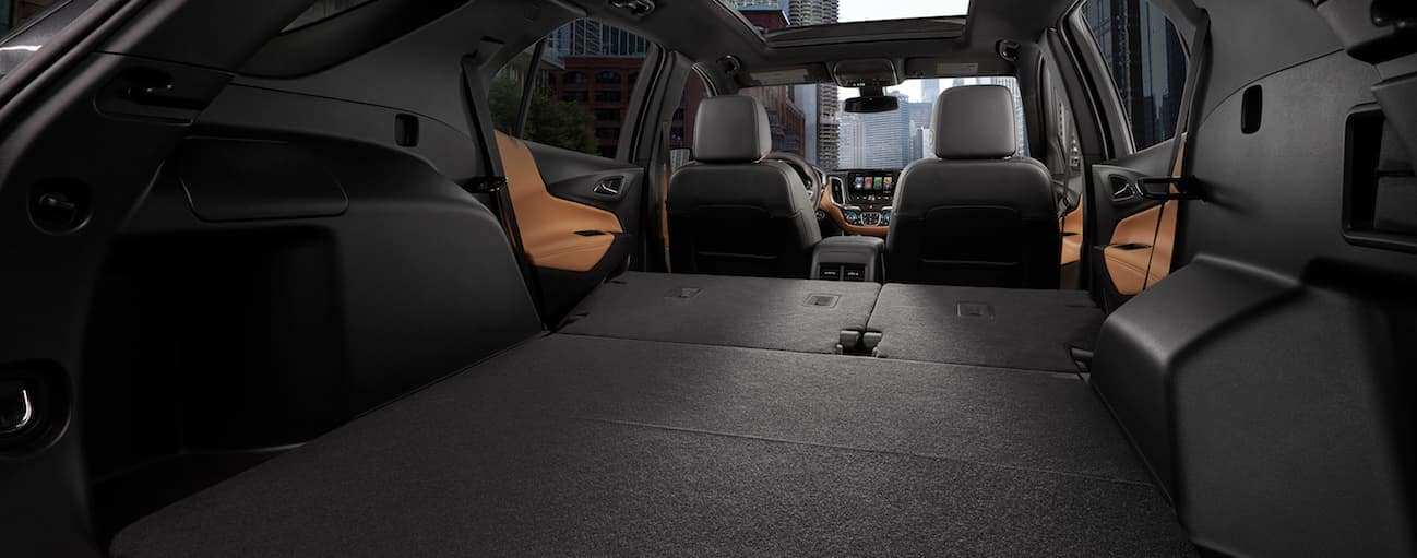 The black long interior of the 2018 Chevy Equinox is shown from the rear to the front.