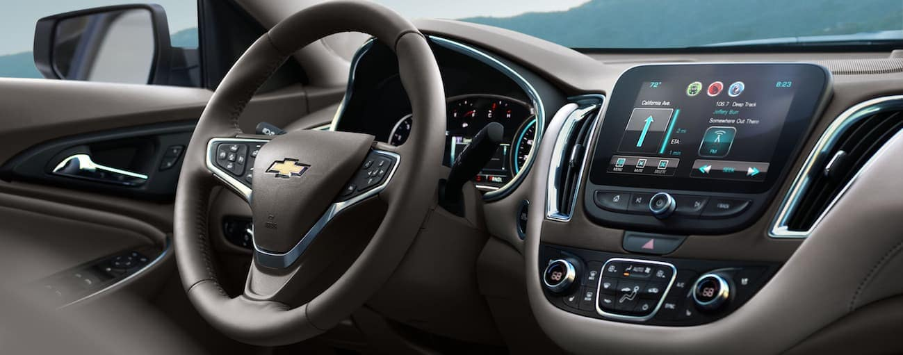 A look at the front interior of the 2018 Chevy Malibu with a touchscreen is shown.