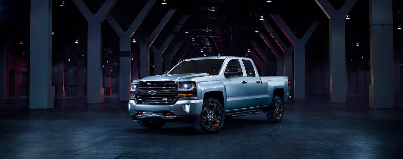 A silver 2018 Silverado special edition, Redline, is parked in a dark garage.