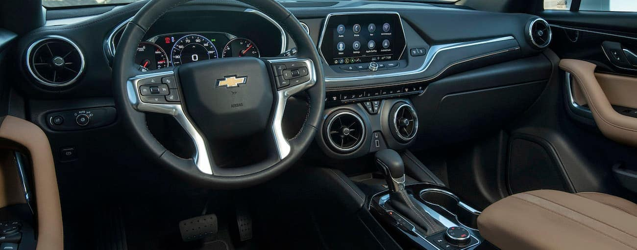The black and tan interior of the 2019 Chevy Blazer is shown.